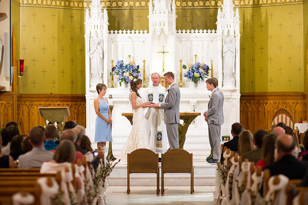 exchanging rings during church ceremony