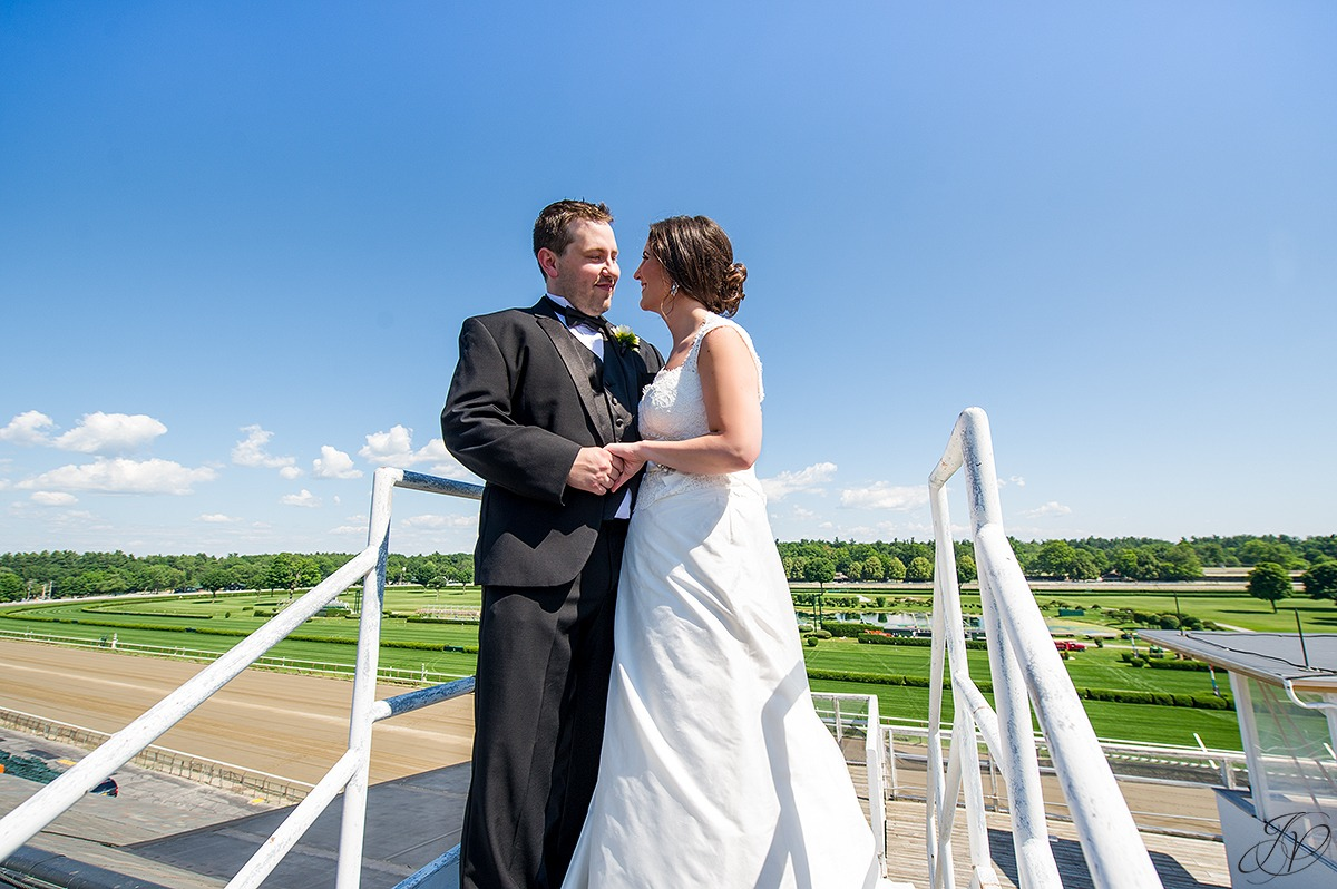 photo of bride and groom with view of saratoga race track