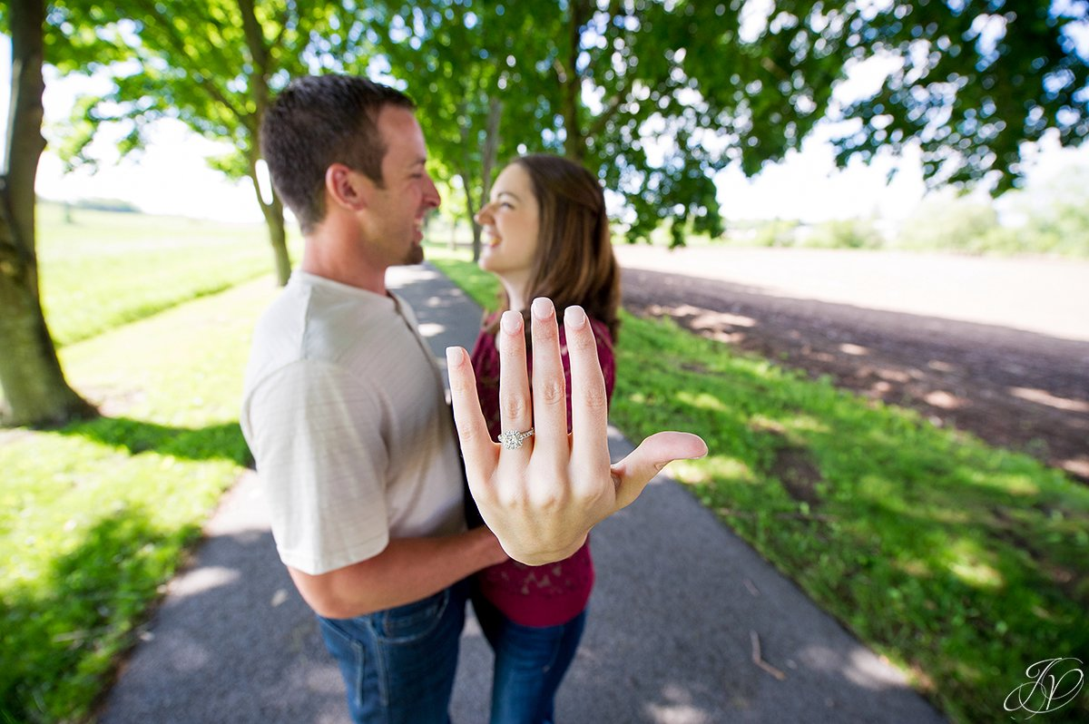 fun photo showing off engagement ring