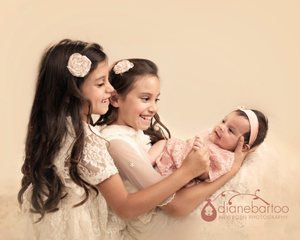 newborn photo with sibling