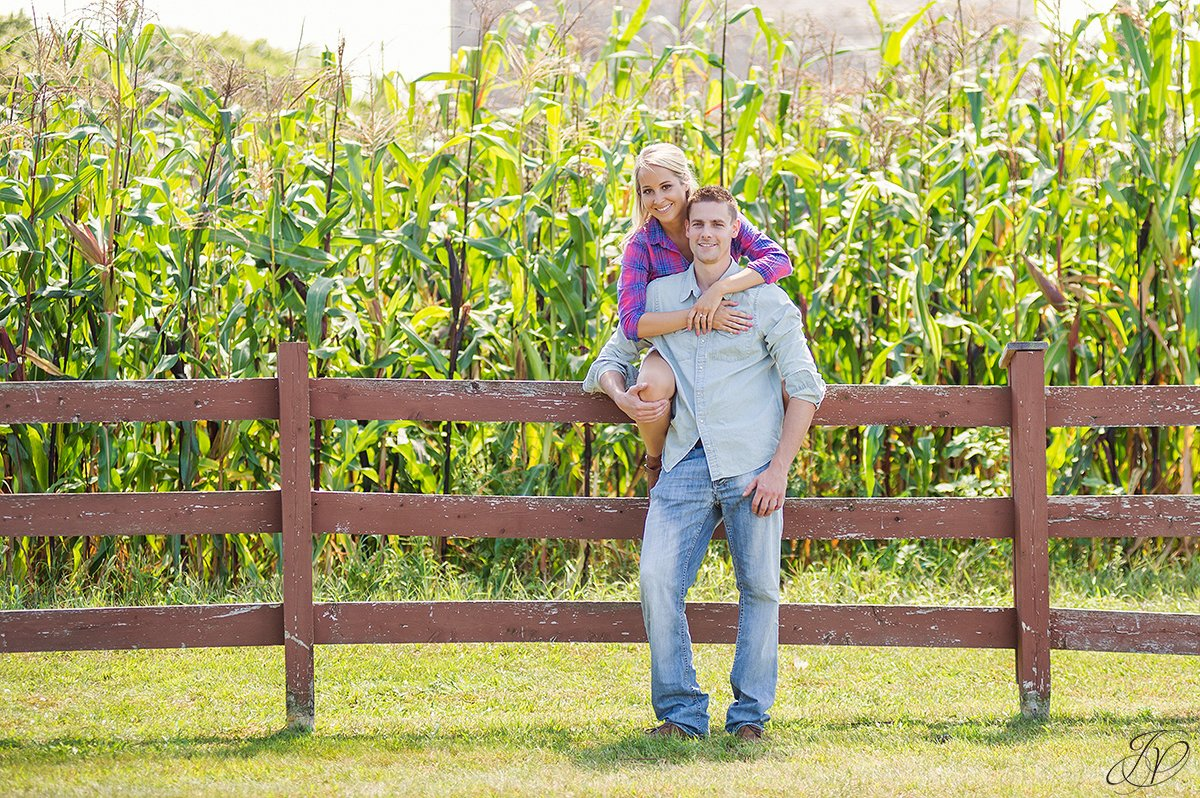 cute engagement photo in front of cornfield