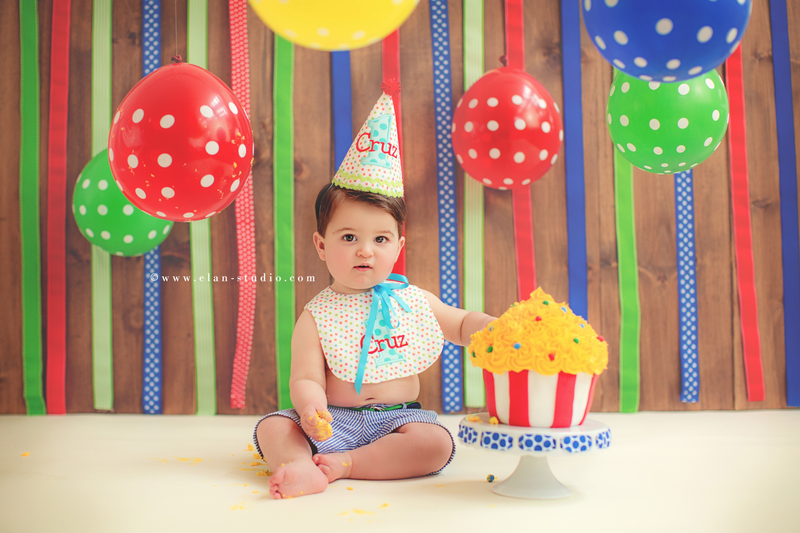 first birthday circus theme cake smash with balloons