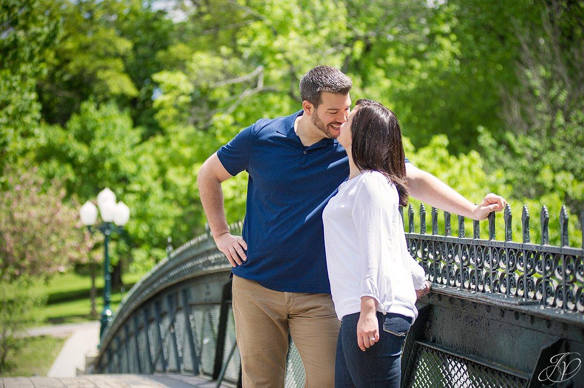 photo of a cute couple on a bridge