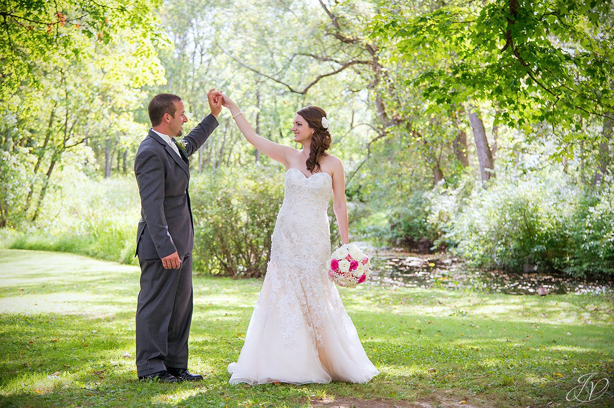 romantic photo of groom twirling his bride