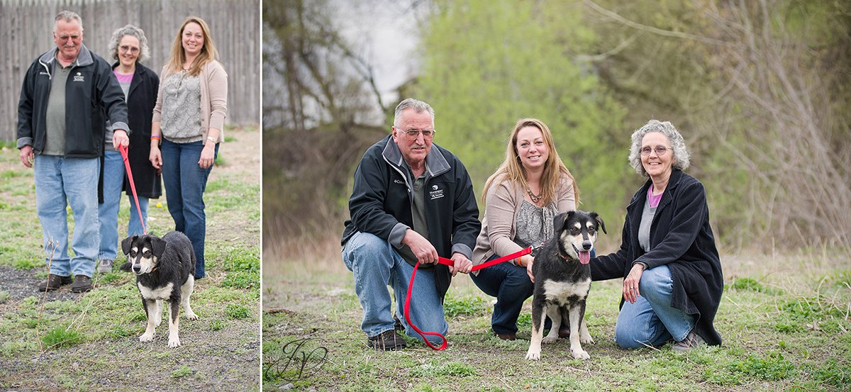 photo of shelter dog with new family and rescuer