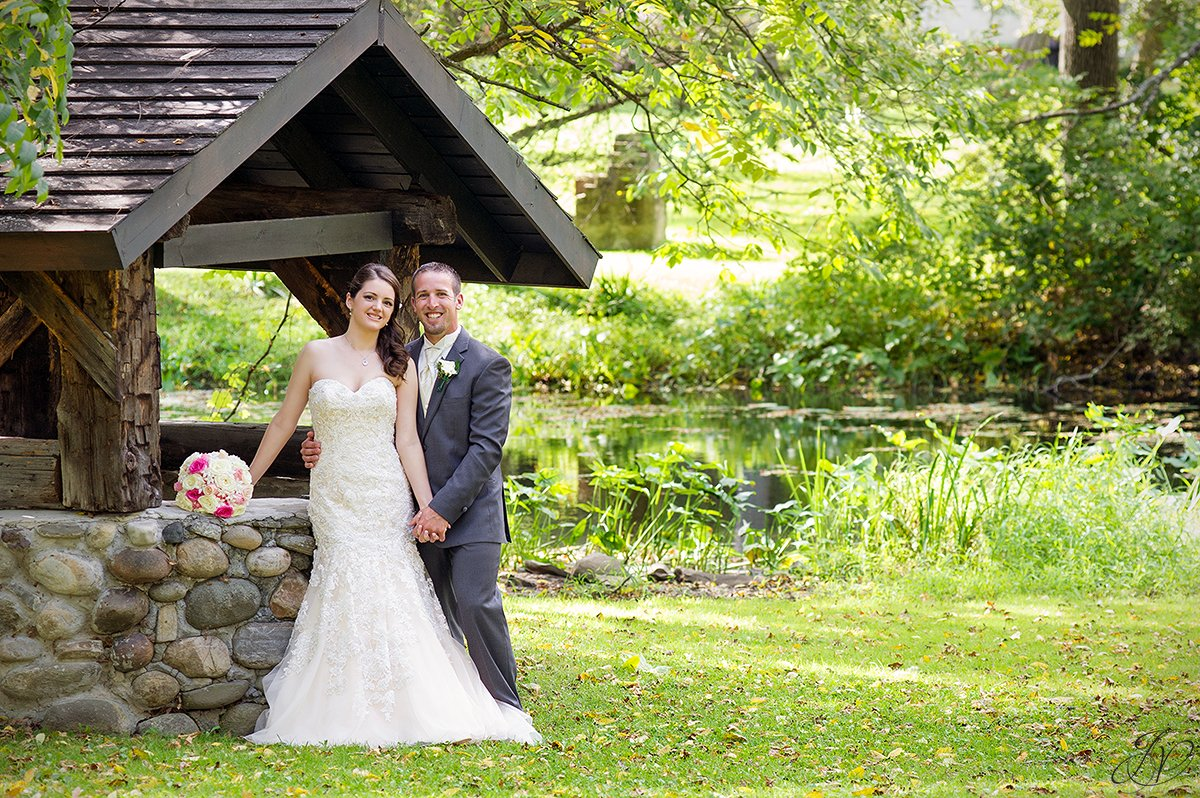 adorable photo of bride and groom near a wishing well