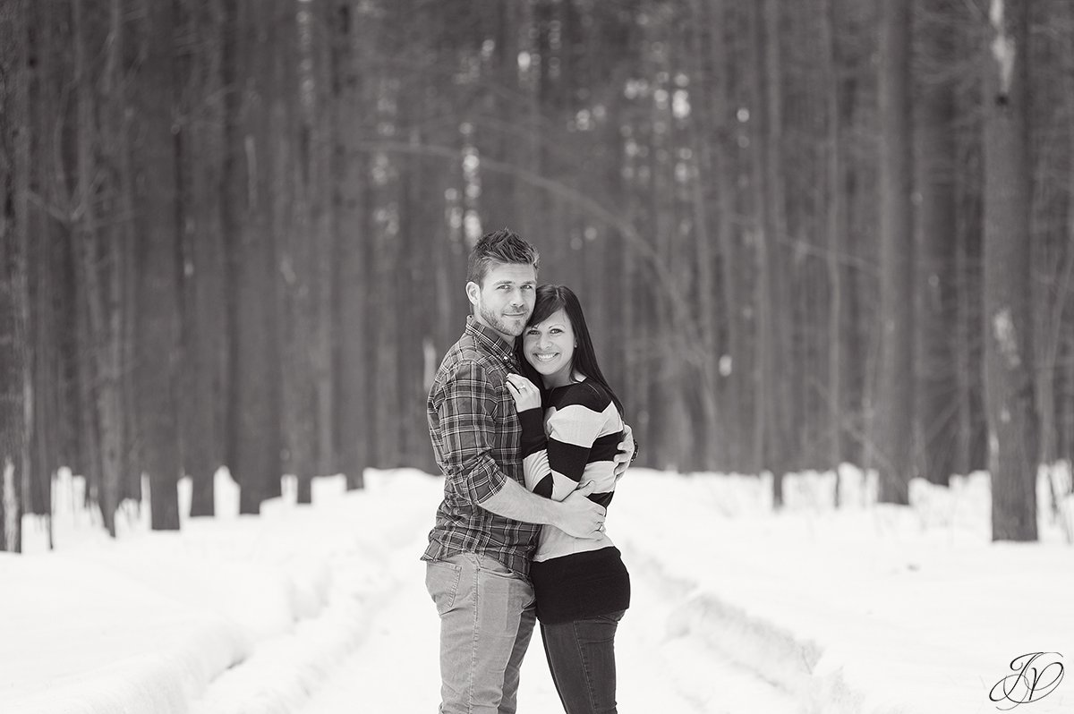 romantic black and white photo of engaged couple in winter