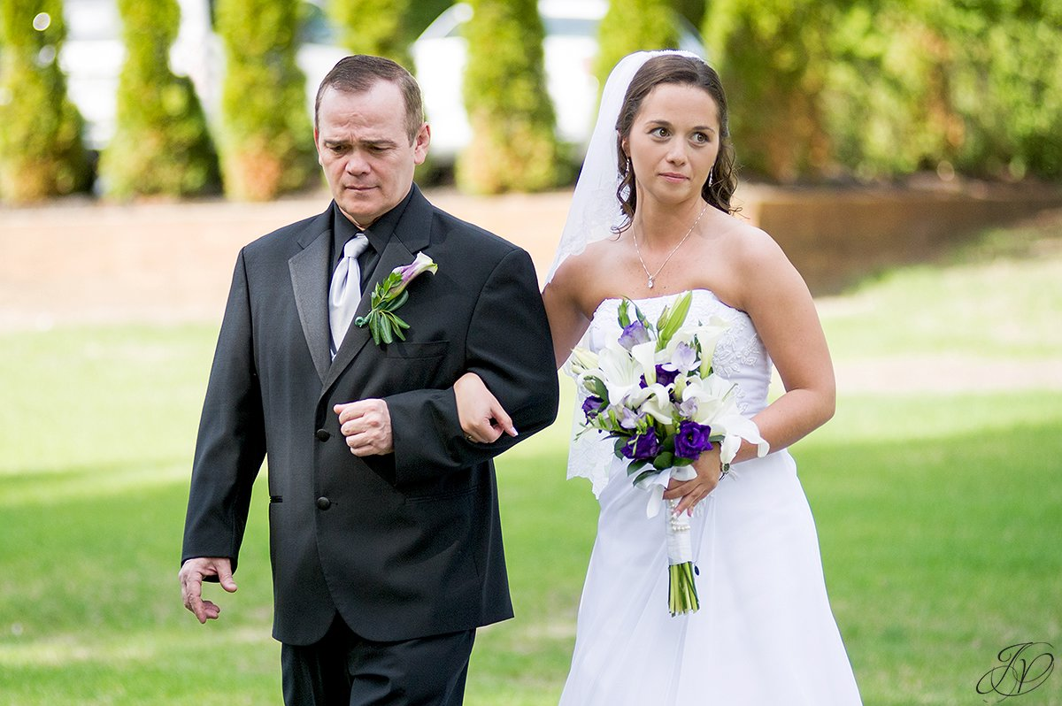 photo of bride coming down the aisle with her father