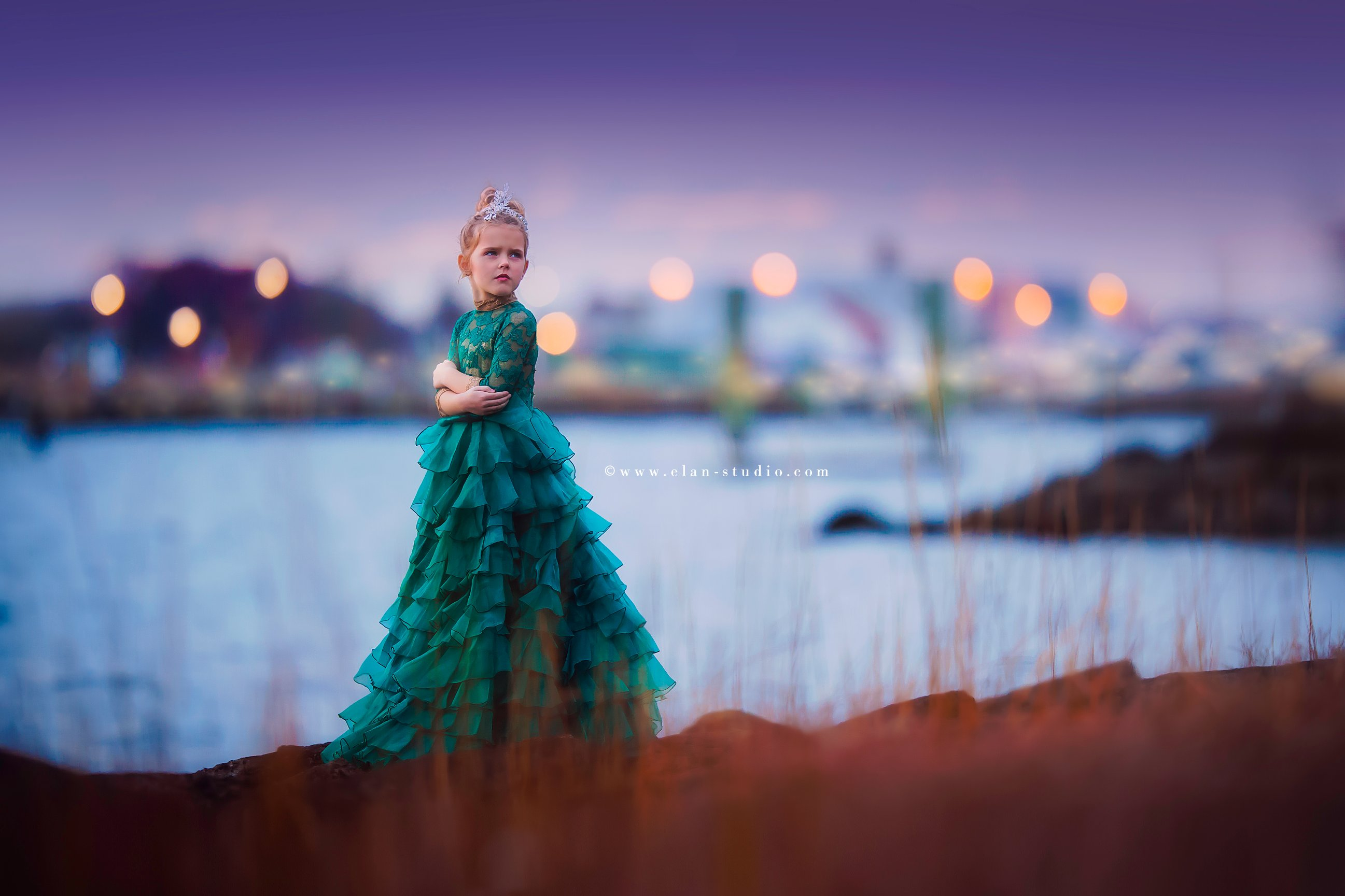 little girl in festive green dress at dusk