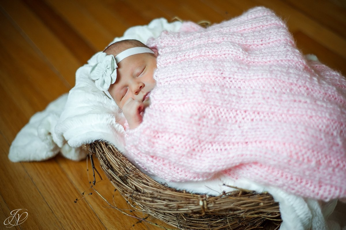 vintage photo of newborn sleeping in basket
