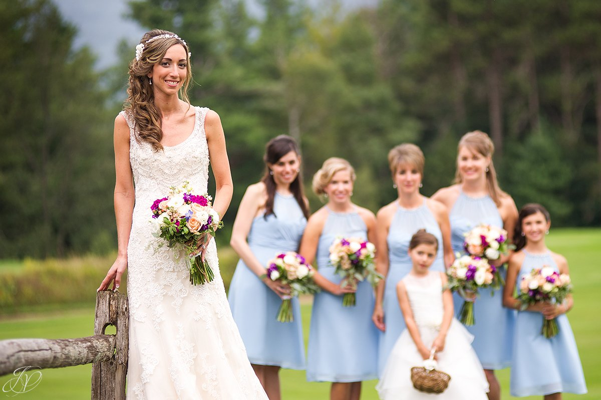 intimate bridal party in light blue lake placid golf club