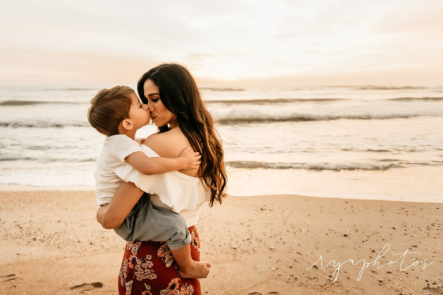 toddler kissing mom's nose, sunrise beach family session, Florida, Ryaphotos