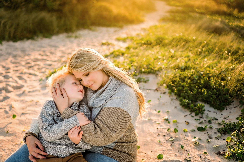 mother and son sitting on sandy beach path, Saint Augustine Beach, Rya Duncklee