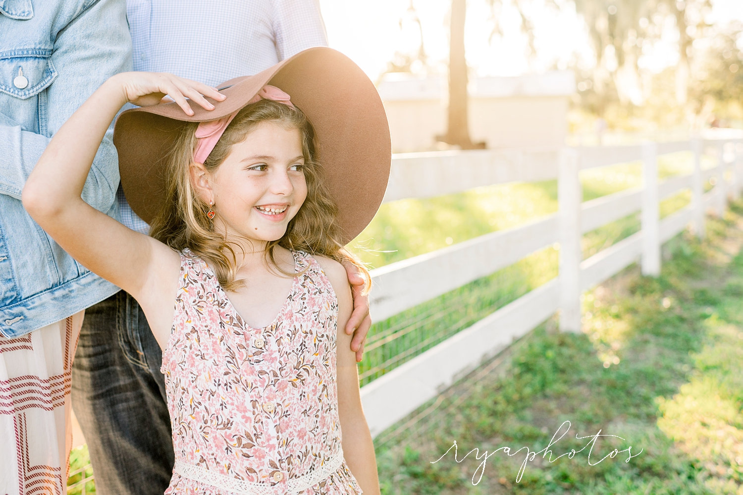 little girl wearing hat, mom and dad, rustic family photo session, Ryaphotos